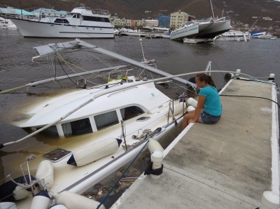 Woman looks at her destroyed catamaran